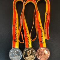 เหรียญรางวัลปีบทองเกมส์ (ด้านหน้า)
