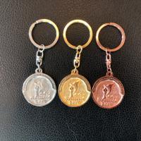 พวงกุญแจปีบทองเกมส์ (ด้านหน้า)