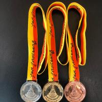 เหรียญรางวัลปีบทองเกมส์ (ด้านหลัง)